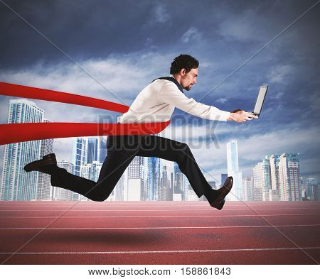 Successful businessman with the computer comes to the end of the race