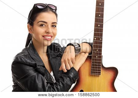 Portrait of a young woman posing with a guitar isolated on white background