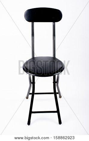 black metal comfortable folding chair nobody seat on white studio