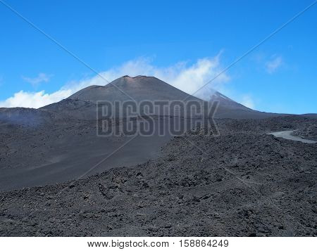 Abandoned fuming Etna crater in May, the tallest active volcano in Europe, Sicily, Italy