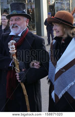26TH NOVEMBER 2016, PORTSMOUTH DOCKYARD, ENGLAND:Two unknown actors playing the part of a victorian couple at the yearly Christmas victorian festival in portsmouth dockyard,england,26th november 2016
