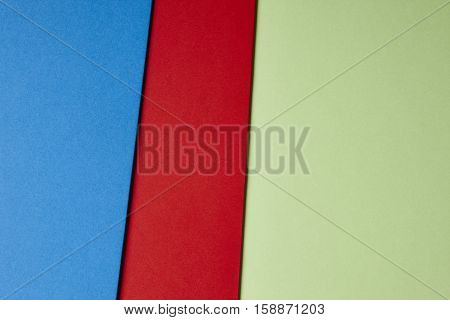 Colored cardboards background in blue red green tone. Copy space. Horizontal