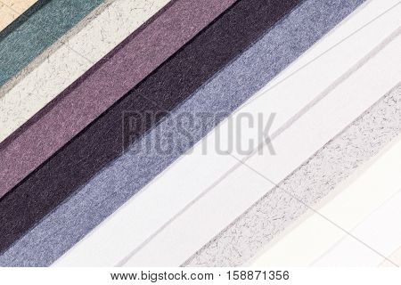 Background of colorful paper parallel vertical oblique stripes