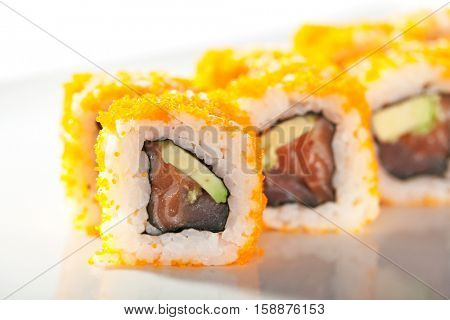 Maki Sushi with Masago  - Roll made of Fresh Raw Salmon, Avocado inside. Masago (smelt roe) outside