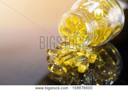 fish oil on the black table with sunlight