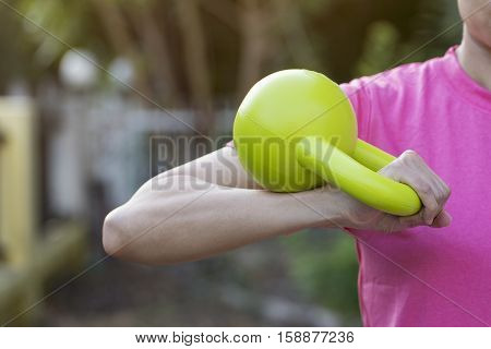 Kettlebell training fitness young woman, close up