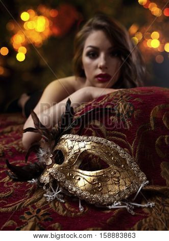 Beautiful Woman With Gold Carnival Mask , Focus On A Foreground
