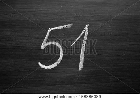 number fifty one enumeration written with a chalk on the blackboard