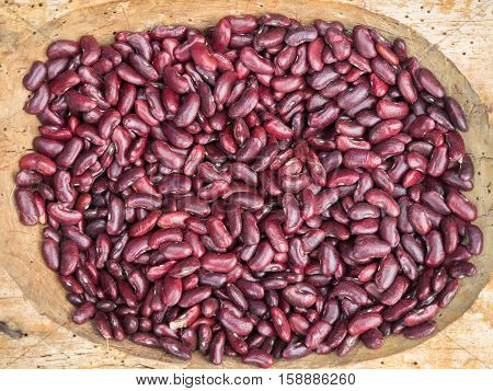 Background of the red shelled beans at the market close up. Shelled beans pattern close up.