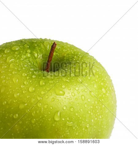 fragment of a green apple with water drops on a white background isolated