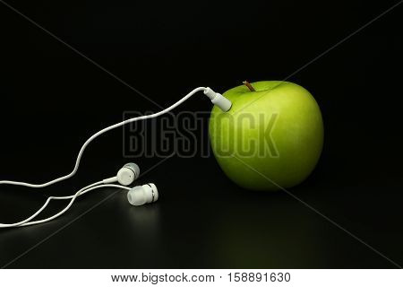 concept apple player on a black background