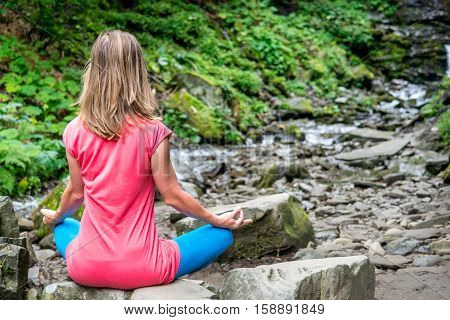 serenity and yoga practicing in the forest