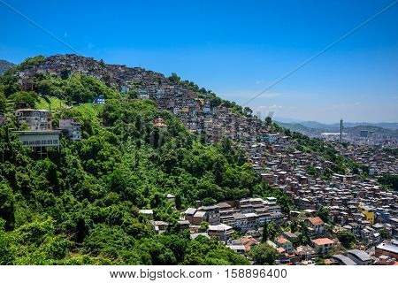 View of Slum, favela Morro dos Prazeres on mountains from Mirante Dona Marta, National Park of Tijuca in Rio de Janeiro, Brazil