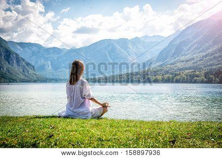 serenity and yoga practicing at the lake Bohinj. Slovenia