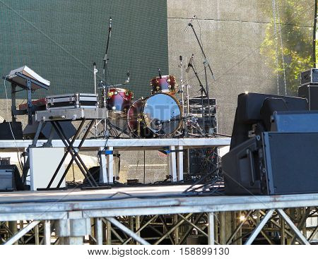 Drum set microphones and speakers on stage ready for concert