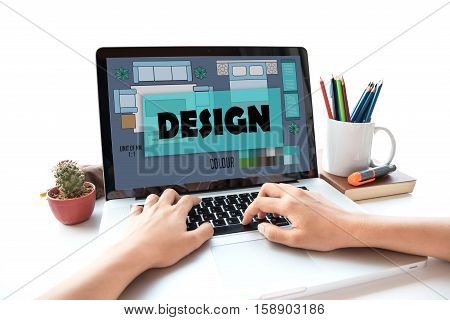 business hand typing on a laptop keyboard with Design on the computer screen creativity ideas decoration concept.
