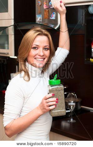 Woman In Kitchen Interior