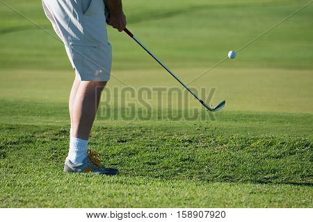 Golfers are hitting the golf ball with the strength of grass spread