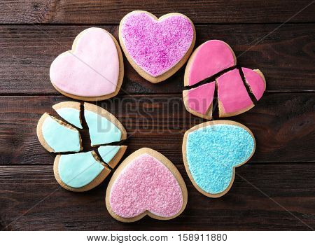 Heart shaped cookies on wooden background, top view