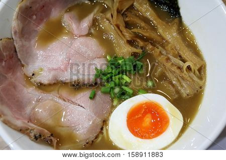 Japanese ramen in Kyoto with pork bamboo shoot and hot spring egg in hot broth