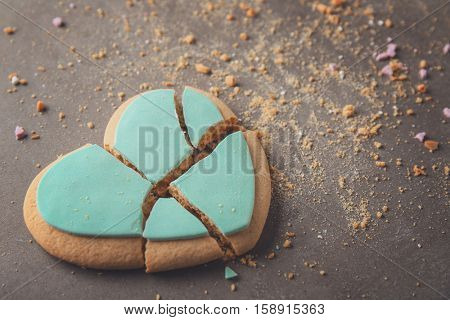 Tasty heart shaped cookie on grey background
