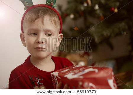 Boy guessing what's in the box