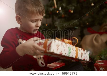 Child opening his gift