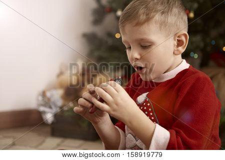Boy enjoying a Christmas gift