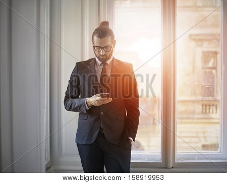 Guy checking his phone for emails