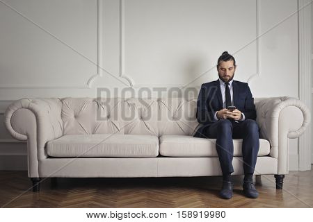 Man waiting on a couch