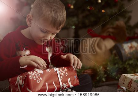Young boy opening a gift