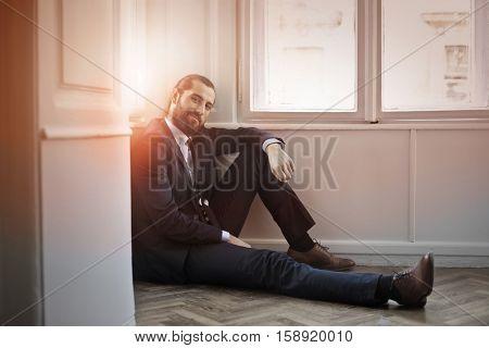 Guy sitting on the floor while enjoying the sunset