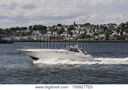 Portland Maine USA - August 9 2009: Yacht cruising along waterfront in Portland Maine