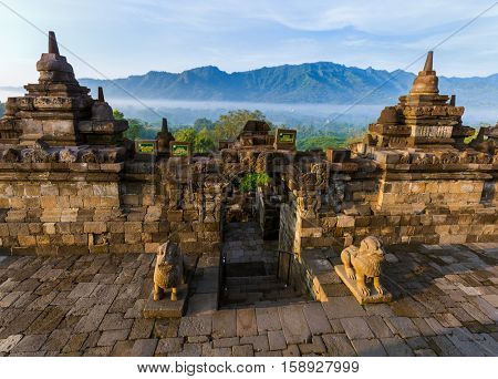 Borobudur Buddist Temple in island Java Indonesia - travel and architecture background