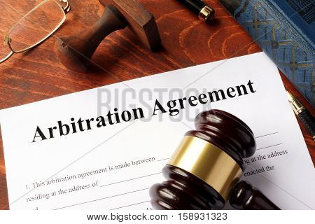 Arbitration agreement form on an office table.