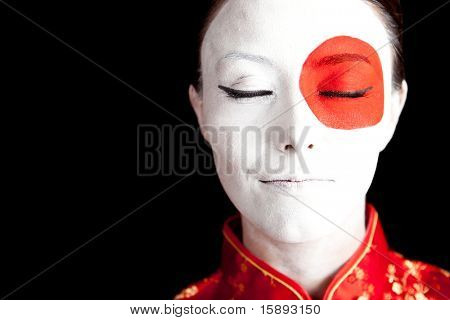 Japanese woman in Asian outfit with the flag painted on her face