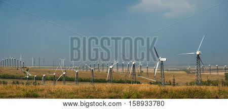 Industrial landscape with wind generators renewable electric power ecological energy