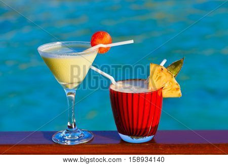Fruit cocktail on Maldives beach - travel background