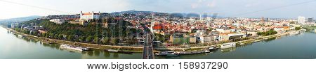 Panoramic shot of Bratislava Slovakia with the Danube River in the foreground