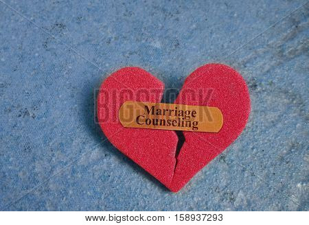 Broken red heart with a Marriage Counseling bandaid