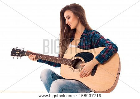portrait of happy girl with guitar in hands smiling isolated on white background