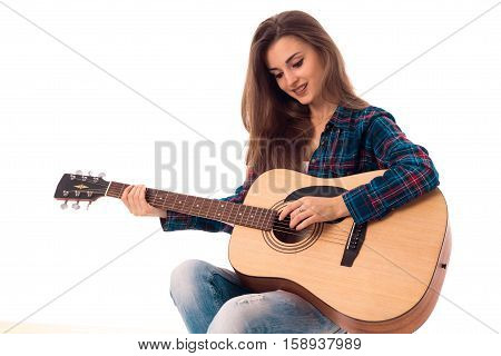 beautiful brunette lady with guitar in hands smiling isolated on white background
