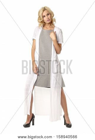 Portrait Of Flirtatious Woman In Cardigan And Dress Isolated On White