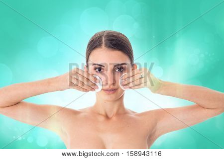 Young attractive girl takes care her skin with Cleansing cotton pad isolated on white background. Health care concept. Body care concept. Young woman with healthy skin.