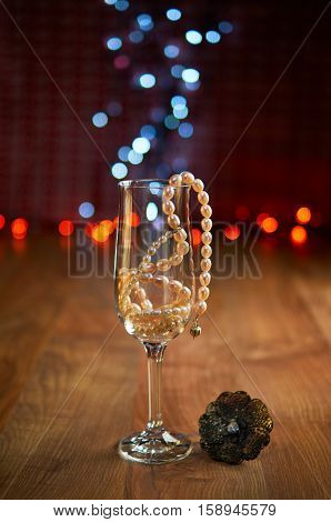 Glass Of Champagne And Beads