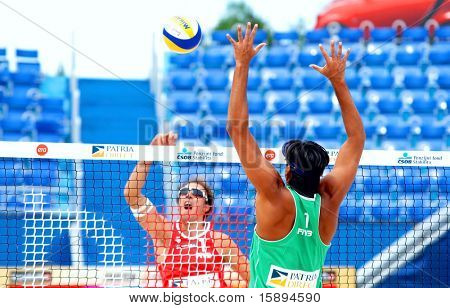 PRAGUE - JUNE 17: Ricardo Santos (BRA) in green on the block at SWATCH FIVB World Tour 2010 June 17, 2010 Prague