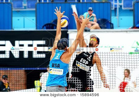 PRAGUE - JUNE 19: Phill Dalhausser (USA) in blue on the block at SWATCH FIVB World Tour 2010 June 19, 2010 Prague