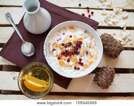Bowl of delicious breakfast muesli in a white ceramic bowl for a healthy nutritious meal