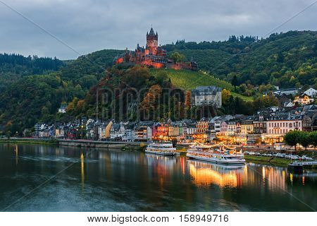 COCHEM, RHINELAND-PALATINATE / GERMANY - OCTOBER 15, 2016: View of the town from the bridge across the Moselle River at dusk, Germany