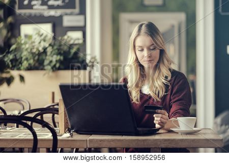 Girl taking a break during her work in a coffee shop
